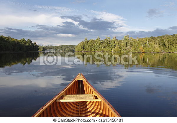 Canoeing on a Tranquil Lake - csp15450401
