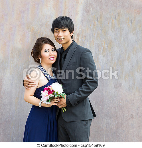 Closeup of Young Adult Couple holding each other on a date - csp15459169