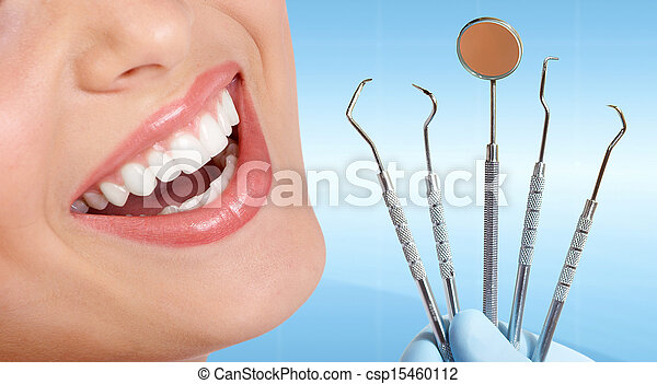 Teeth with dental tools. - csp15460112