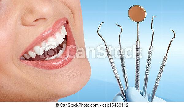 Teeth with dental tools. - csp15460112