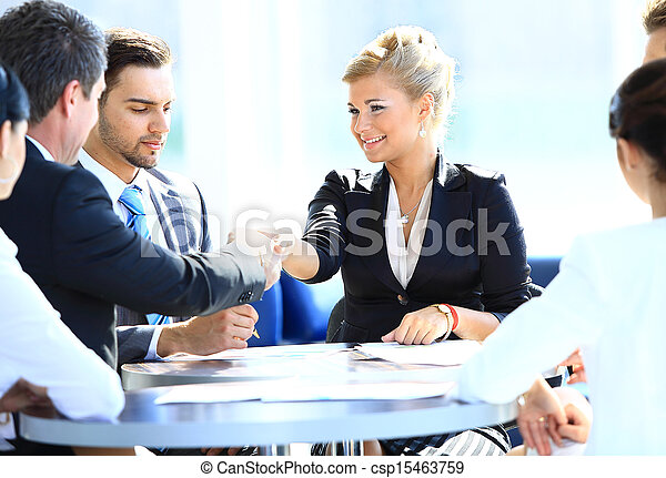 Happy business man and woman shaking hands - csp15463759