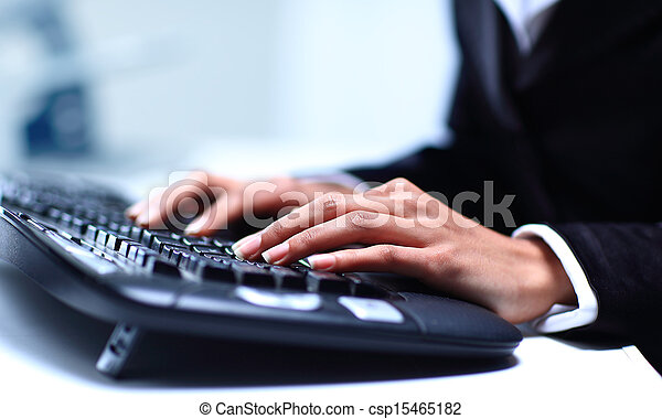 Female hands typing on computer keyboard - csp15465182