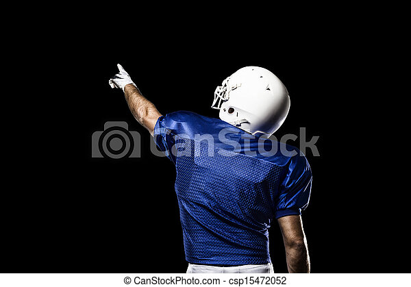 Football Player with a blue uniform celebrating on a Black background.
