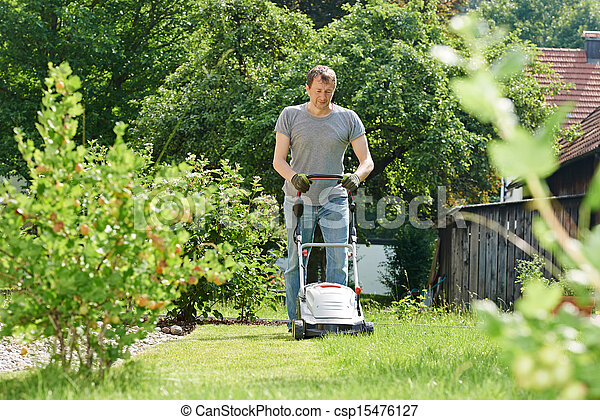 man mowing lawn in backyard - csp15476127