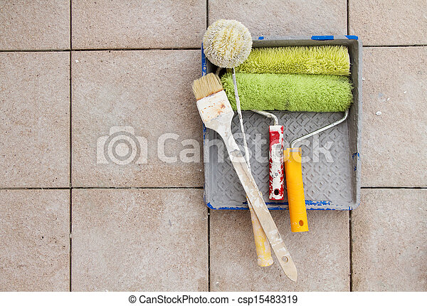 Repair tools over stone floor tile background. Copy space. - csp15483319