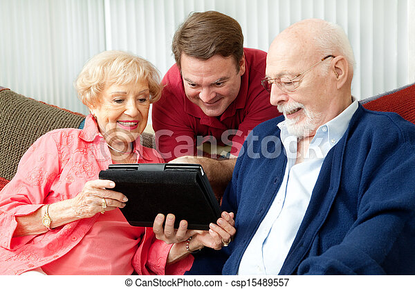 Family Using Tablet Computer - csp15489557