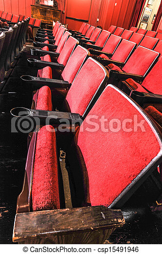 Rows of theater seats with wooden arm rests - csp15491946