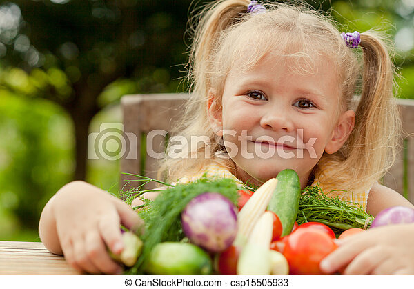 Happy little girl with vegetables . Concept of healthy food. - csp15505933