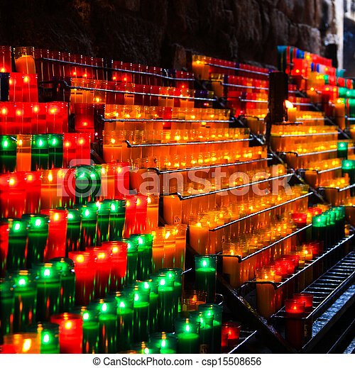 Lots of Candles burning in a church - csp15508656