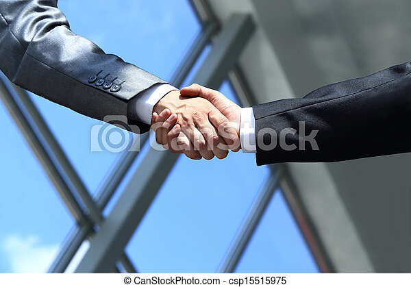 business people shaking hands in office - csp15515975