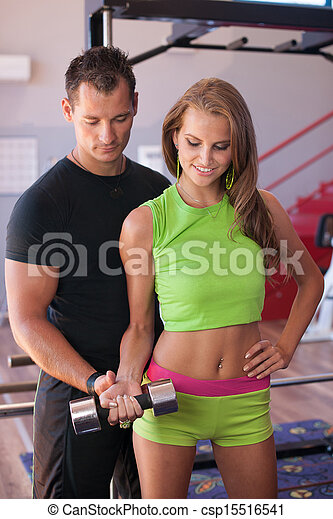 Active young woman works out with coach