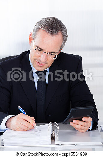 Businessman Working On Computer - csp15561909
