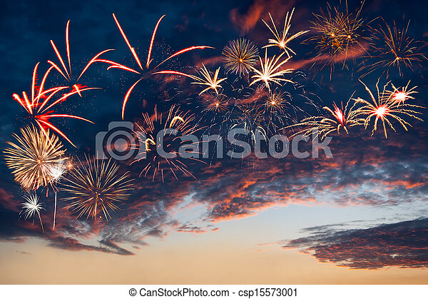Beautiful fireworks in the evening sky with majestic clouds. Christmas, New Year and other holiday - csp15573001