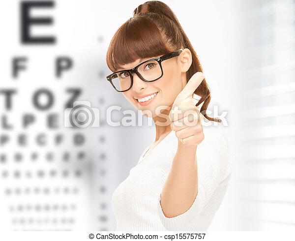 woman in eyeglasses with eye chart - csp15575757