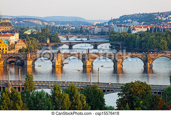 View of the Vltava River and the bridges shined with the sunset sun, Prague, the Czech Republic - csp15576418