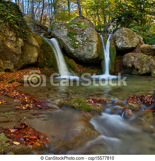 Landscape with autumn waterfall in the mountains - csp15577810