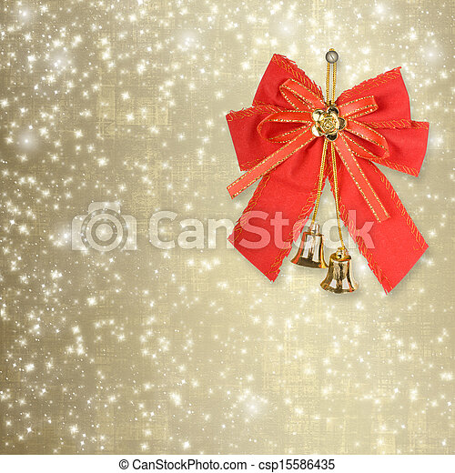 Red Christmas bow with golden bells on an abstract background