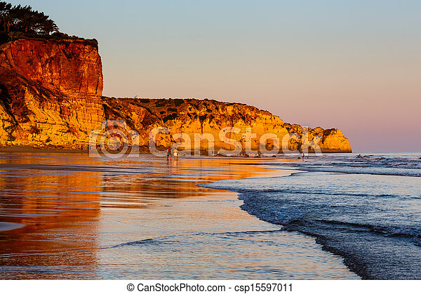 Sunset at Porto de Mos Beach in Lagos, Algarve, Portugal - csp15597011