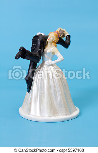 Stock Image of Funny wedding cake topper - Bride and groom ...