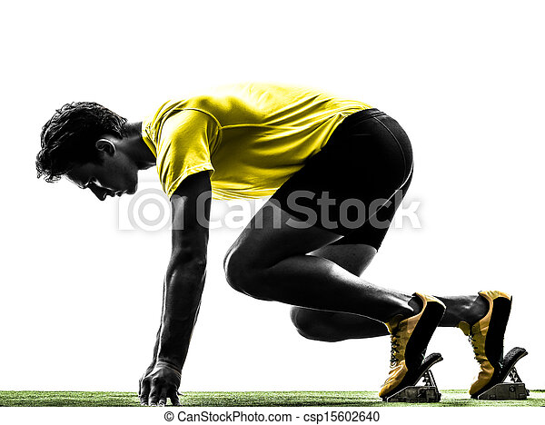 young man sprinter runner in starting blocks silhouette - csp15602640