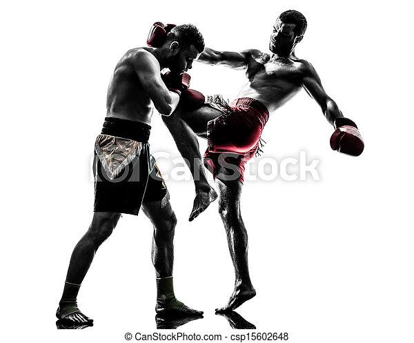 two men exercising thai boxing silhouette - csp15602648