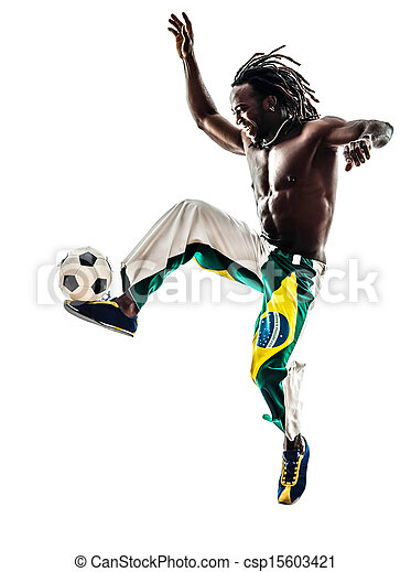 brazilian  black man soccer player juggling football - csp15603421