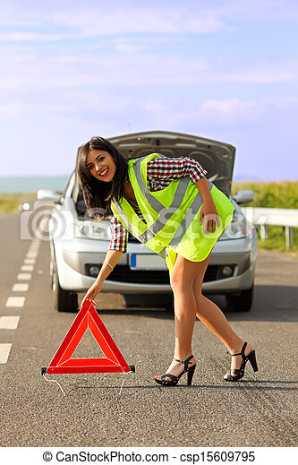 Woman placing emergency triangle - csp15609795