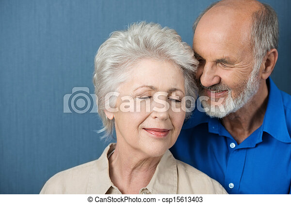 Elderly couple share a tender moment - csp15613403