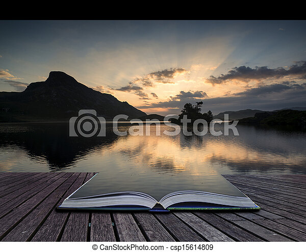 Creative concept pages of book Beautiful sunrise reflected in calm Cregennen Lakes in Snowdonia National Park - csp15614809