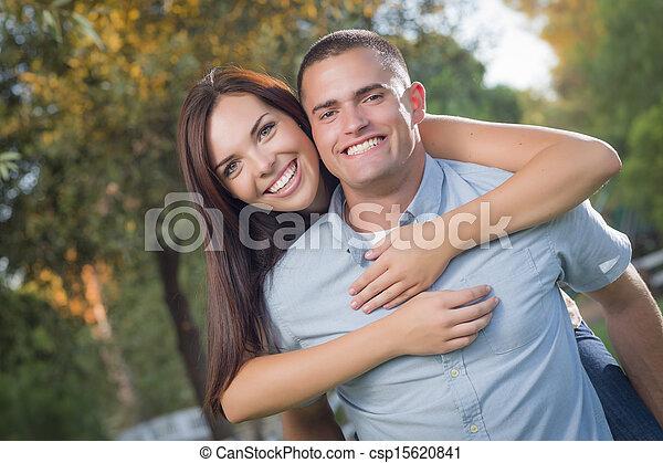 Mixed Race Romantic Couple Portrait in the Park - csp15620841