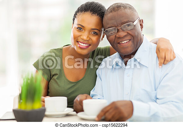 young adult african girl and father having coffee - csp15622294