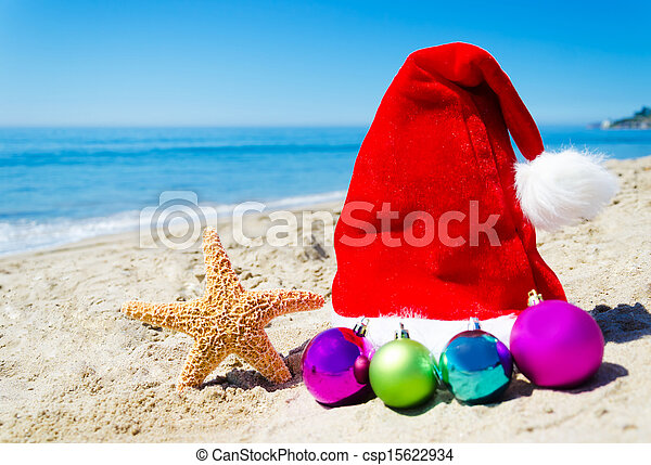 Starfish with christmas hat and balls on the beach