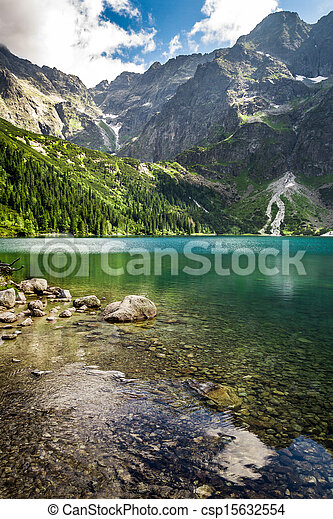 Mountain lake in summer on the background of rocky mountains - csp15632554