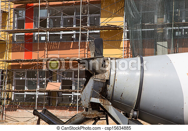 Cement trucks on the background of construction