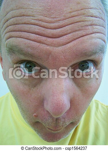 Man with wrinkled forehead - csp1564237