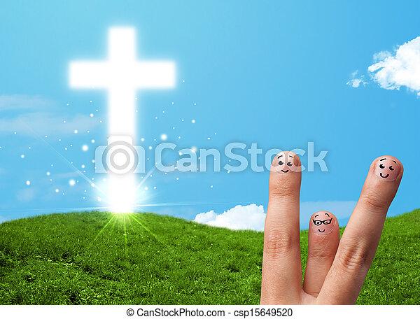 Happy finger smileys with christian religion cross - csp15649520