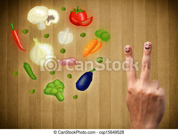 Happy smiley face fingers cheerfully looking at illustration of colorful healthy vegetables - csp15649528