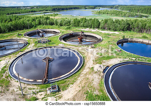 Aerial view of industrial wastewater treatment plant in evergreen forest - csp15650888