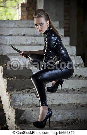 photo de cuir femme robe couteau combat femme jouer a csp15656340 recherchez des. Black Bedroom Furniture Sets. Home Design Ideas