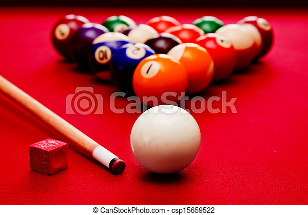 Billards pool game. Cue ball, cue, color balls in triangle, chalk. Red cloth table - csp15659522