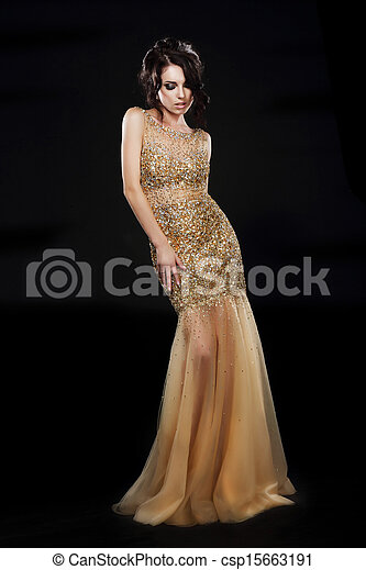 Vogue. Beautiful Fashion Model In Golden-Yellow Dress over Black - csp15663191