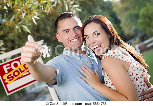 Military Couple with House Keys and Sold Real Estate Sign - csp15664756