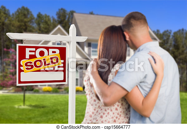 Sold For Sale Sign with Military Couple Looking at House - csp15664777
