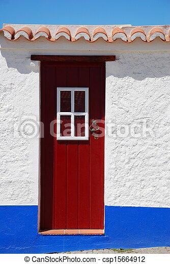 Rural door in a little village, Porto Covo, Portugal  - csp15664912