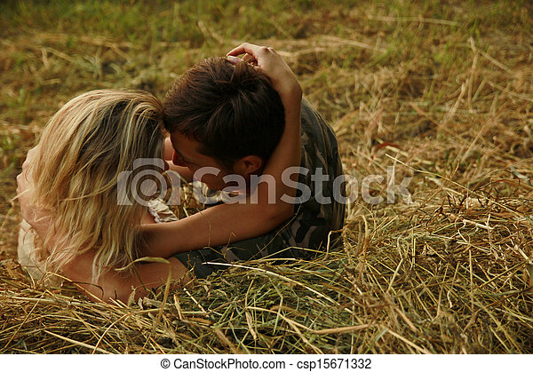 couple in love on a haystack in nature - csp15671332