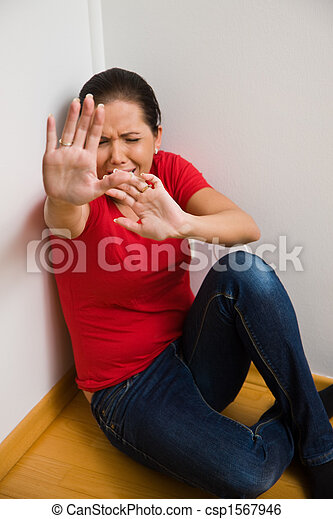anxious woman symbol of violence in the family - csp1567946