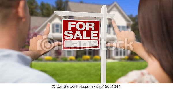 For Sale Sign, House and Military Couple Framing Hands - csp15681044