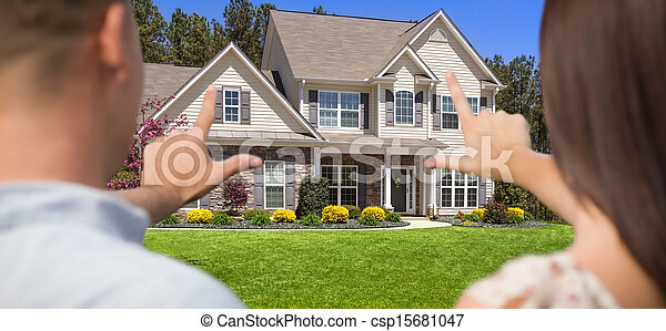 House and Military Couple Framing Hands in Front - csp15681047