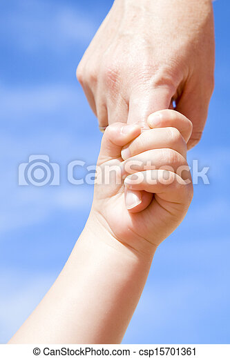 Adult holding a child by the hand - csp15701361