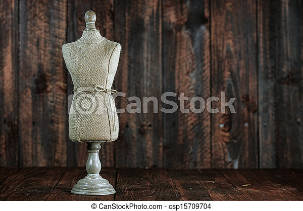 Antique Mannequin Busts on Wood Grunge Background - csp15709704